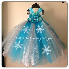 Cute Elsa dress for Alana's Frozen inspired birthday party, but I don't care for the flowers.... maybe see if that can be changed to have a ribbon sash.