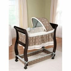 Carter's Animal Parade Wood Bassinet by Summer Infant. Animal Parade, a new collection from Carter's®, is inspired by the marketplace wonders of the world. The classic comfort wood bassinet can easily be wheeled into the parent's bedroom so baby can be by your side at night. The bassinet features a beautiful stylish solid wood frame with espresso finish that complements any decor. $159.99