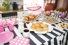 "preppy pink + navy pancakes and pajamas party: pancakes with syrup, sausages, donut holes, bagels, striped baking cups with strawberries, mini cereal boxes, and faux ""bacon and eggs"" treats (pretzel sticks + melted candy melt and yellow M ""egg"")"