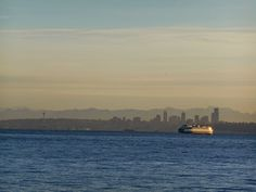 Seattle ferry and Seattle skyline at sunrise from Manchester.