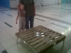 a pallet table, old cast iron legs found on a scrap dump. made it with my son, Sias.