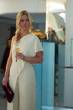 In the scene at the art gallery, Georgina sports the most chic one-shouldered cream jumpsuit we've ever seen. With clean lines and a flattering shape, this may be our favourite outfit from the show.