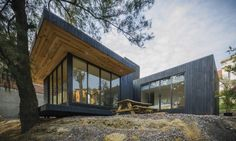 Revolution Architects designed the Black Cabin, a compact green-roofed dwelling surrounded by nature in Mexico City. Timber Cabin, Timber Roof, Cabin Design, House Design, Ideas De Cabina, Modular Cabins, Jungle House, Villa, Wooden Cabins