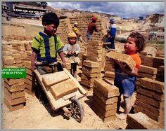 children working. NOT at school. Grrr. (MariaJose: Oliviero Toscani)