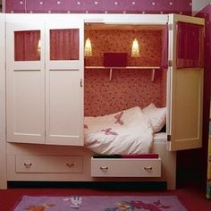 Hidden pink bed inside a closet with storage. So cute for a little girl's room
