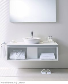 layout of powder room vanity; floating. Two storage areas, one with a dirty towel hole cutout of the slab and dirty towels go into one drawer, the other drawer is clean towels & t.p....... Duravit badkamers