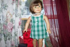 Jumper for 18 inch Doll in green and white plaid with white lace at neckline and 2 pearly white decorative buttons on front of bodice. Green hook & loop tape secures the dress back from neck to lower back and a white cotton lining is secured inside the bodice of the dress. Machine wash warm, tumble dry low or hang dry, press with warm iron if necessary.  This listing is for the DRESS only, doll and other accessories are not included.   Make sure to check our full inventory. Purchase 4 or...