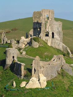 Corfe Castle, Corfe Mullen, Dorset. Corfe Castle is a fortification standing above the village of the same name in the English county of Dorset. Built by William the Conqueror, the castle dates back to the 11th century and commands a gap in the Purbeck Hills on the route between Wareham and Swanage.