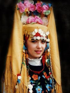 Bulgaria . ~~    Traditional Bulgarian head decoration, ornamented with flowers and golden coins.
