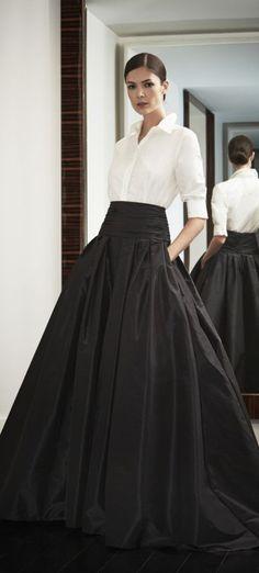 White blouse with full black skirt.