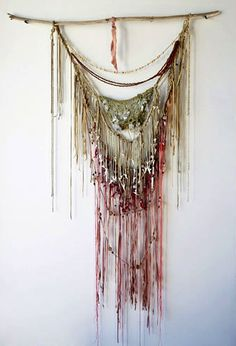 Feathe by Jun Funahashi wall hanging: peach and cream leather macrame with weaved in crystals, corals and shark teeth collected on the beaches of Japan. Via beautifuldreamers.com