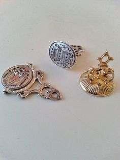Three 18th century small wax-seal - silver one - silver swivel one - gold with agate All three I think made in Holland.In present collection.