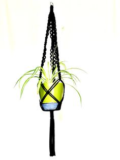 Black macrame hanging planter on Etsy, $22.89 AUD