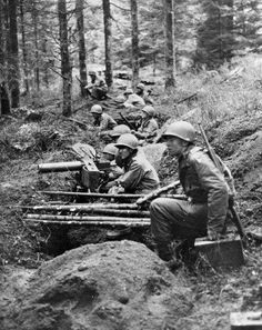 US troops on a trench line in the Hurtgen forest the border between Belgium and Germany. December 1 1944