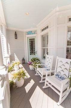 Beautiful porch with blue ceiling and aqua door - A Beach House Built Near the Ocean in Norfolk Virginia