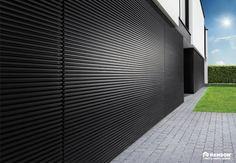 sectionaal poort loopt over in muurbekleding l-door.be