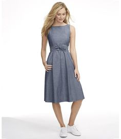 Breezy soft indigo chambray, in our infinitely flattering fit-and-flare silhouette. Improved tailoring for a more natural fit through the top and skirt. Side pockets. Removable self-fabric tie belt at natural waist. Concealed back zipper. Fully lined. 100% cotton. Imported. Machine wash and dry.