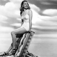 Doris Day in a one-piece swim suite and cute sandals.