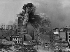 Warsaw Uprising, 1944 - The Prudential building was Warsaw's tallest skyscraper and was hit by approximately 1000 artillery shells during the uprising. On August camera man Sylwester Braun captured the moment of impact of a mortar artillery shell Warsaw Ghetto Uprising, War Photography, Documentary Photography, History Photos, Ww2 Photos, Second World, Military History, World War Two, Wwii