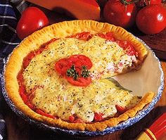 Tomatoe Pie- I had a friend back in the day that would visit the Amish Country and always brought back their famous Tomatoe Pie, I've since then get my mother to make it from time to time, though the Amish People make it the best, they just have the right touch with it !!! YUMMY