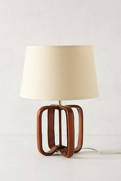 Yellow or Blue Color would suit our theme of Yellow/Grey/Blue     Saddle Strap Lamp Base    #anthropologie
