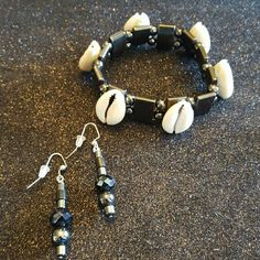 Hematite Stone cowrie  bracelet w/ Earrings set Hematite Stone Cowrie Shells Bracelet with Hematite Stone earrings.  Hematite stones bracelet is good for arthritis and wrist/ hand pain. Comes with free inspirational bookmarker. Jewelry Bracelets