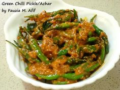 Green Chilli Pickle/Achar | Fauzias Kitchen Fun250gm green chilies, cleaned and dried 4 tbsp. oil ½ tsp. rai/mustard seeds 4-5 limro/curry leaves ¼ tsp. garlic paste 2 level tbsp. gram flour/besan 1 tsp. salt (or to taste) 1 tsp. red chili powder ¼ tsp. turmeric powder 1 tsp. tomato paste 1 tbsp. lemon juice 1 tsp. sugar 1 tbsp. achar masala water