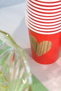 Hearts cut out of wood-grain contact paper(from dollar store) stuck onto paper cups. You could write kids names on the hearts. So cute.