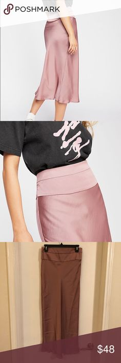 87a572c067 Free People Skirt 8 . Free People Normani Bias Skirt Size 8 . Unlined .  Dawn Mauve color . Side Zipper Closure . Brand new with tag.