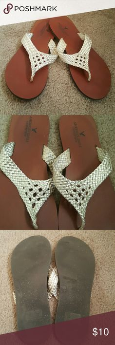 flip flops flip flops with thick gold straps American Eagle Outfitters Shoes Sandals