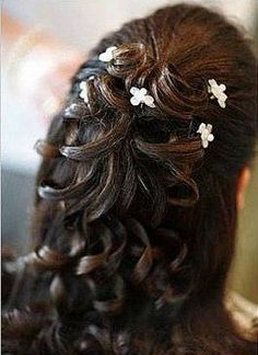 Love the pull back and the loose front but tight enough to help shape my face. Could add some small stray hairs cascading down around the face. Hair is down which is good and the flowers are cute and go with the theme. I love the twisted and intertwined curls. Not sure how it would work with the veil, but I would definitely put it in the runnings.