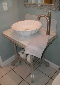Awesome Websites We converted an antique table to a vanity Here us some DIY tips Gray with marble counter and backsplash and white vessel sink from Overstock
