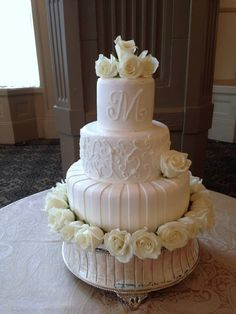 White wedding cake with pale yellow roses