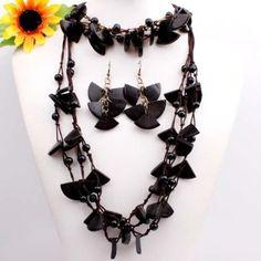 Black wooden necklace, bracelet, and earring set