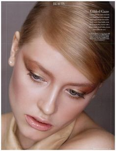 """Magazine: L'Officiel March 2011, Singapore  Photographer: GT Gan  Featuring: Olesya Romanenko  Make up: Justina Tan  Styling: Toety Liang    """"Channel Sharon Tate's mod chic with glistening bronze and gold. Dust a gold shade from lashes to the crease, the boldy circle the eye along the contour with a bronze shade. Finish with a brown liner under the eyes."""""""