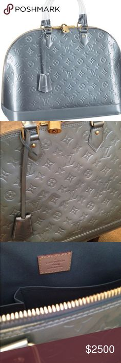 Louis Vuitton Vernis Alma GM- Bleu Givre -Golden brass pieces (hardware) - Integral closure by double zipper - Two inside patch pockets and a mobile phone compartment - Leather label on interior with country of origin (subtle dot on label- see photo) - Hand held or carried on the shoulder - A padlock provides extra security for the closure of the bag (subtle scratch) - Removable key bell (contains key for padlock) - Bottom studs to protect the base of the bag (slight scratches) Louis Vuitton…