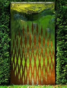 Modern oxidised water wall garden sculpture. Outdoor wall art
