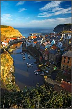 Staithes is a seaside village in the Scarborough, North Yorkshire, England. Yorkshire England, North Yorkshire, Whitby England, England Uk, Yorkshire Dales, Scarborough England, Northern England, Travel England, Great Places