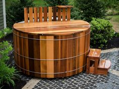 A Japanese-style hot tub, constructed of Canadian Western Red Cedar, nestles on the patio's edge. The wood-fired unit is equipped with an electric pump and an electric ionizer.