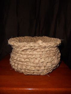 Medium sized planter basket made from  ruff strips of suiting. Flared lip