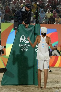 Daniele Lupo of Italy discusses with the referee during the Men's Beach Volleyball Gold medal match against Alison Cerutti and Bruno Schmidt Oscar of Brazil at the Beach Volleyball Arena on Day 13 of the 2016 Rio Olympic Games on August 18, 2016 in Rio de Janeiro, Brazil.