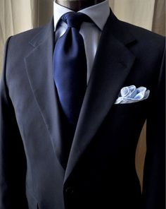 "The ""Italian background"": a navy tie paired with a light blue shirt is a classic and versatile combination allowing the expression of creativity through one's jacket and accessories. The look is ubiquitous in Italy."