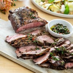A lovely idea for a relaxed Christmas Day is to barbecue the main. Adding a chimichurri sauce will add a bit of spice to the classic lamb and rosemary c Farro Recipes, Lamb Recipes, Barbecue Recipes, Bbq, Barbecued Lamb, Marinated Lamb, Tasty, Yummy Food, Chimichurri