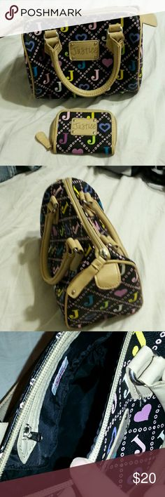 Never used leather Justice purse with wallet Black and cream leather with hearts and j's on it Justice Bags Mini Bags