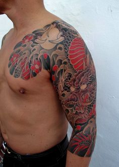 Dragon chest plate and arm sleeve with red. Chris Garver