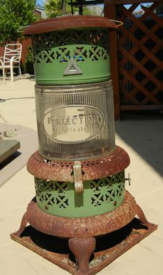 """This unique antique oil heater stands at tall. Perfect for garden display. Or for the fixer-upper out there, the paint is original- and the rust is """"authentic"""". Kerosene Heater, Kerosene Lamp, Vintage Space, Vintage Stuff, Vintage Decor, Vintage Furniture, Painted Furniture, Vintage Antiques, Garden Wood Burner"""