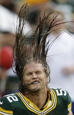 Green Bay Packers linebacker Clay Matthews flips his hair before a preseason NFL football game against the Cleveland Browns Thursday, Aug. 16, 2012, in Green Bay, Wis.
