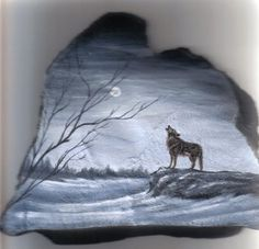 wintery wolf painting on rock