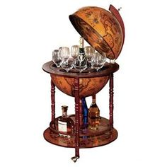 "Serve guests in stately style with this globe-inspired bar. The top opens to reveal storage for stemware and bottles, while the lower shelf keeps your favorite whiskeys and gins on hand.  Product: Globe barConstruction Material: Wood and metalColor: BrownFeatures:  Turned legsInterior storage for bottles and glassware Dimensions: 38.5"" H x 22"" DiameterAssembly: Assembly required"