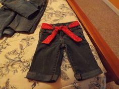 Turn your kid's jeans into Bermuda shorts!  My kids wear the knees out of their jeans within two seasons so to get the most of my money, we turn them into shorts in the spring.  I also sew little belts with scrap fabric so they can mix and match them however they like.  Very easy, check it out on my website at www.kcmin.com - Click on The Natty Gambit (my blog) or just click through my photo.